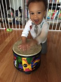 young baby drumming